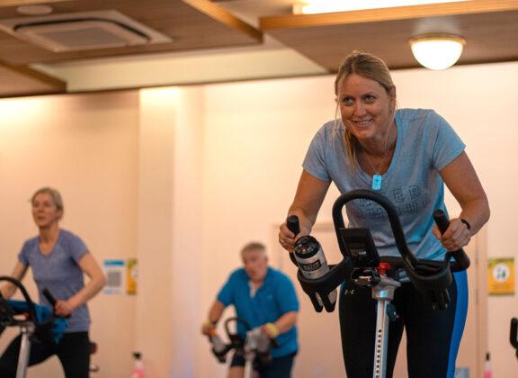 Lady on fitness bike